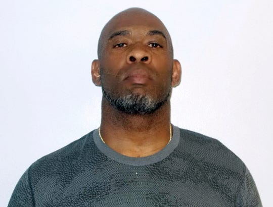 This booking photo released Monday, May 13, 2019, by the Concord Police Department shows Greg Spires, a former NFL football player accused of violating a protective order in Concord, N.H.