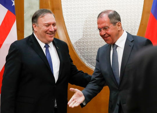 Russian Foreign Minister Sergey Lavrov, right, welcomes U.S. Secretary of State Mike Pompeo for the talks in the Black Sea resort city of Sochi, southern Russia, Tuesday, May 14, 2019.
