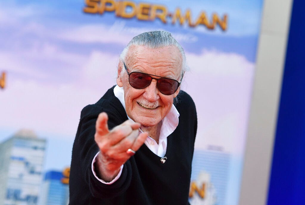 """In this June 28, 2017 file photo, Stan Lee arrives at the Los Angeles premiere of """"Spider-Man: Homecoming"""" at the TCL Chinese Theatre. A former business manager of Lee has been charged with five counts of elder abuse of the late Marvel Comics mogul."""