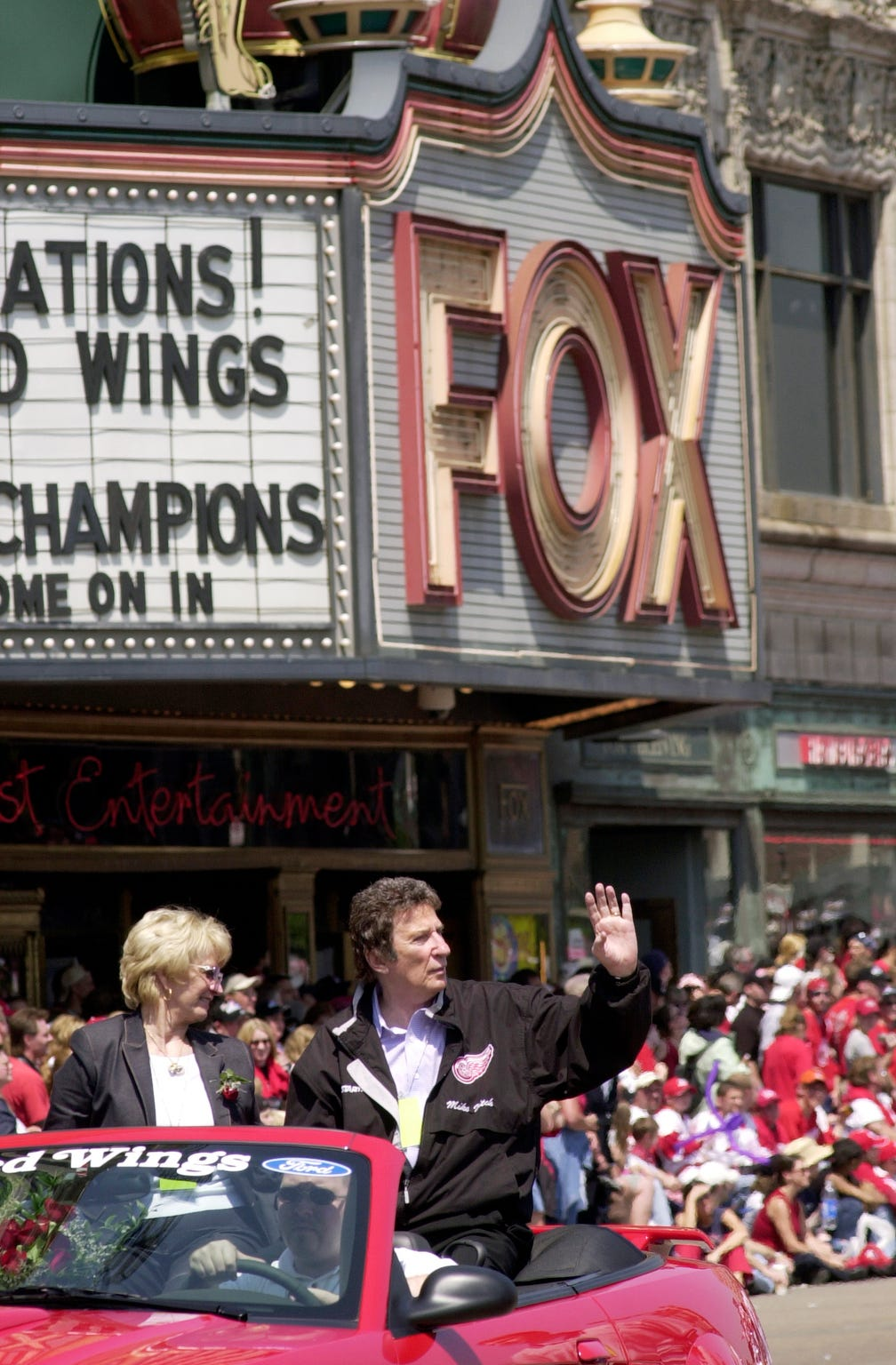 Marian and Mike Ilitch rode an open car  in the Red Wings victory parade on Woodward Ave. near the Fox Theatre  in  Detroit on June 17, 2002.