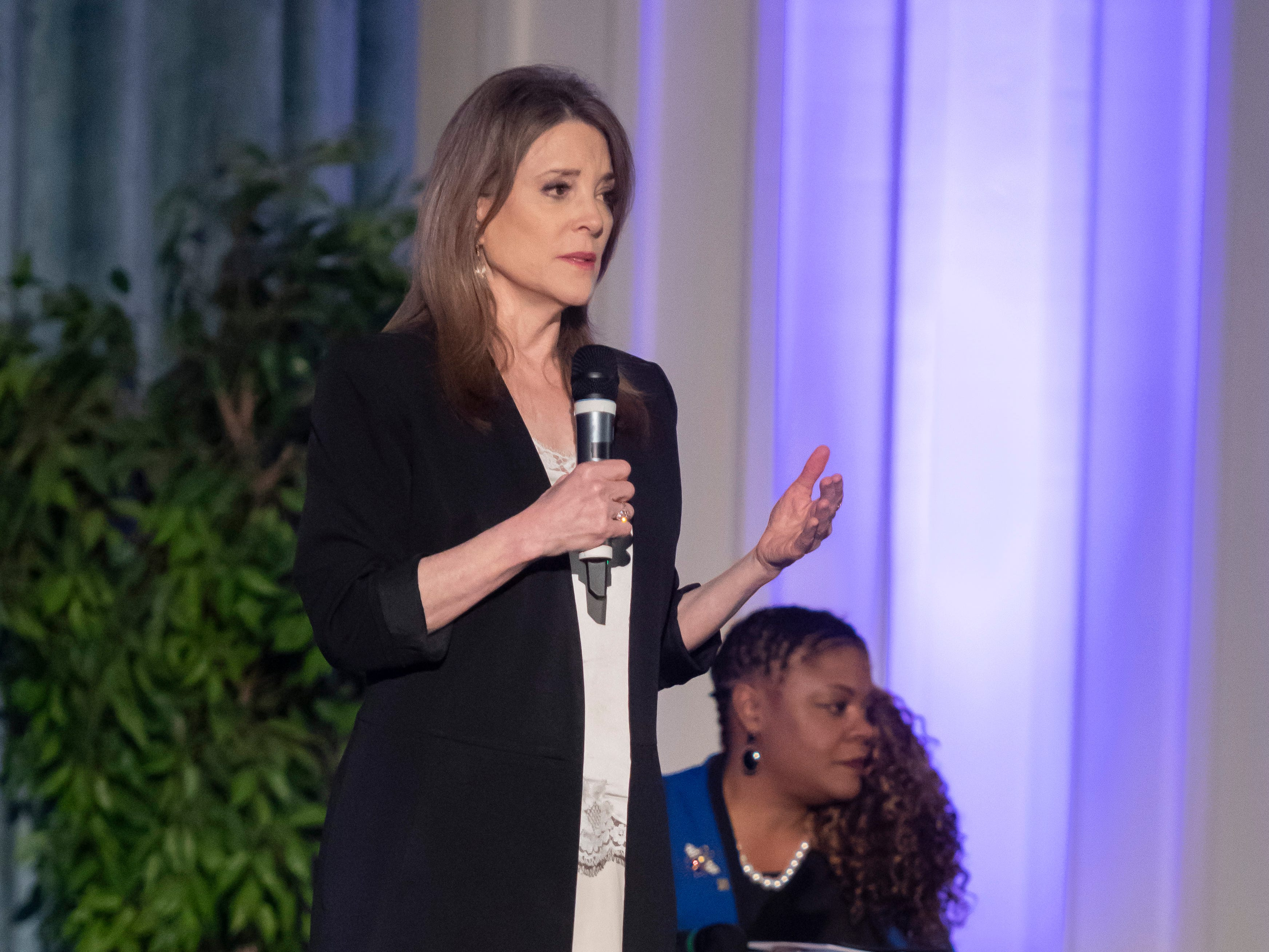 Author and Presidential candidate Marianne Williamson speaks at a town hall at the Detroit Unity Temple, in Detroit.