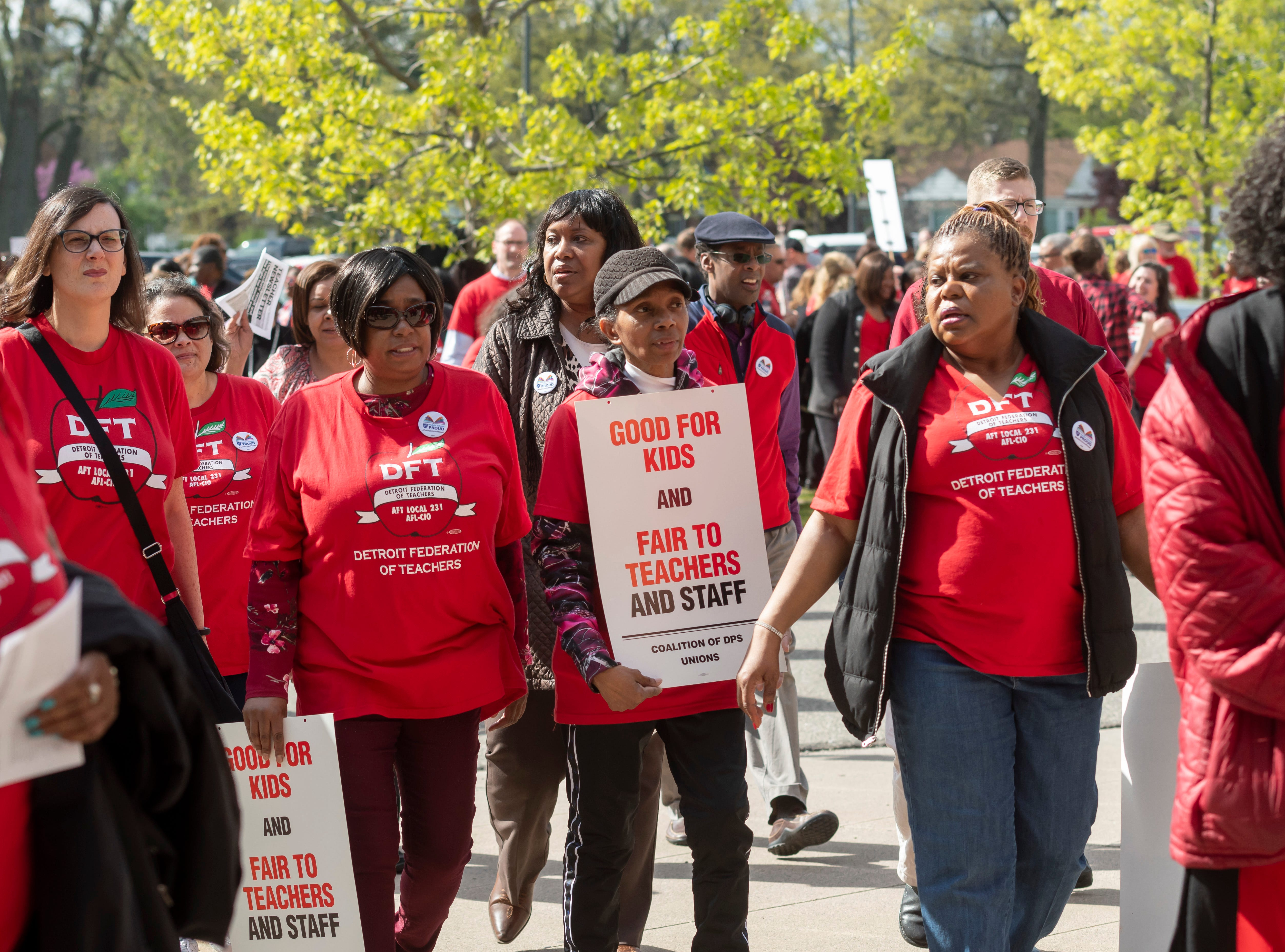 Detroit teachers and their friends and family protest before a school board meeting at Renaissance High school, in Detroit, May 14, 2019. The teachers were upset over a new calendar, teacher pay, building conditions and class sizes.