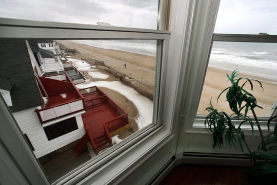 A view out the window of an oceanfront condo in Salisbury, Mass.
