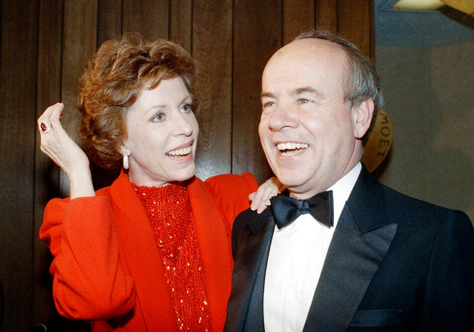 """In this April 26, 1986 file photo, Carol Burnett, left, and veteran comrade in comedy Tim Conway laugh during a gala birthday party for Burnett in Los Angeles.  Conway, the impish second banana to Burnett who won four Emmy Awards on her TV variety show, starred aboard """"McHale's Navy"""" and later created a very short character named Dorf, has died. He was 85."""