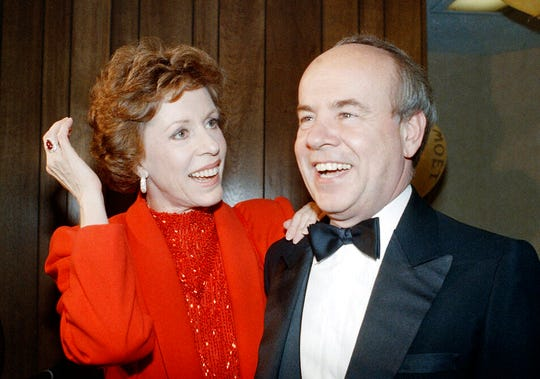 "In this April 26, 1986 file photo, Carol Burnett, left, and veteran comrade in comedy Tim Conway laugh during a gala birthday party for Burnett in Los Angeles.  Conway, the impish second banana to Burnett who won four Emmy Awards on her TV variety show, starred aboard ""McHale's Navy"" and later created a very short character named Dorf, has died. He was 85."