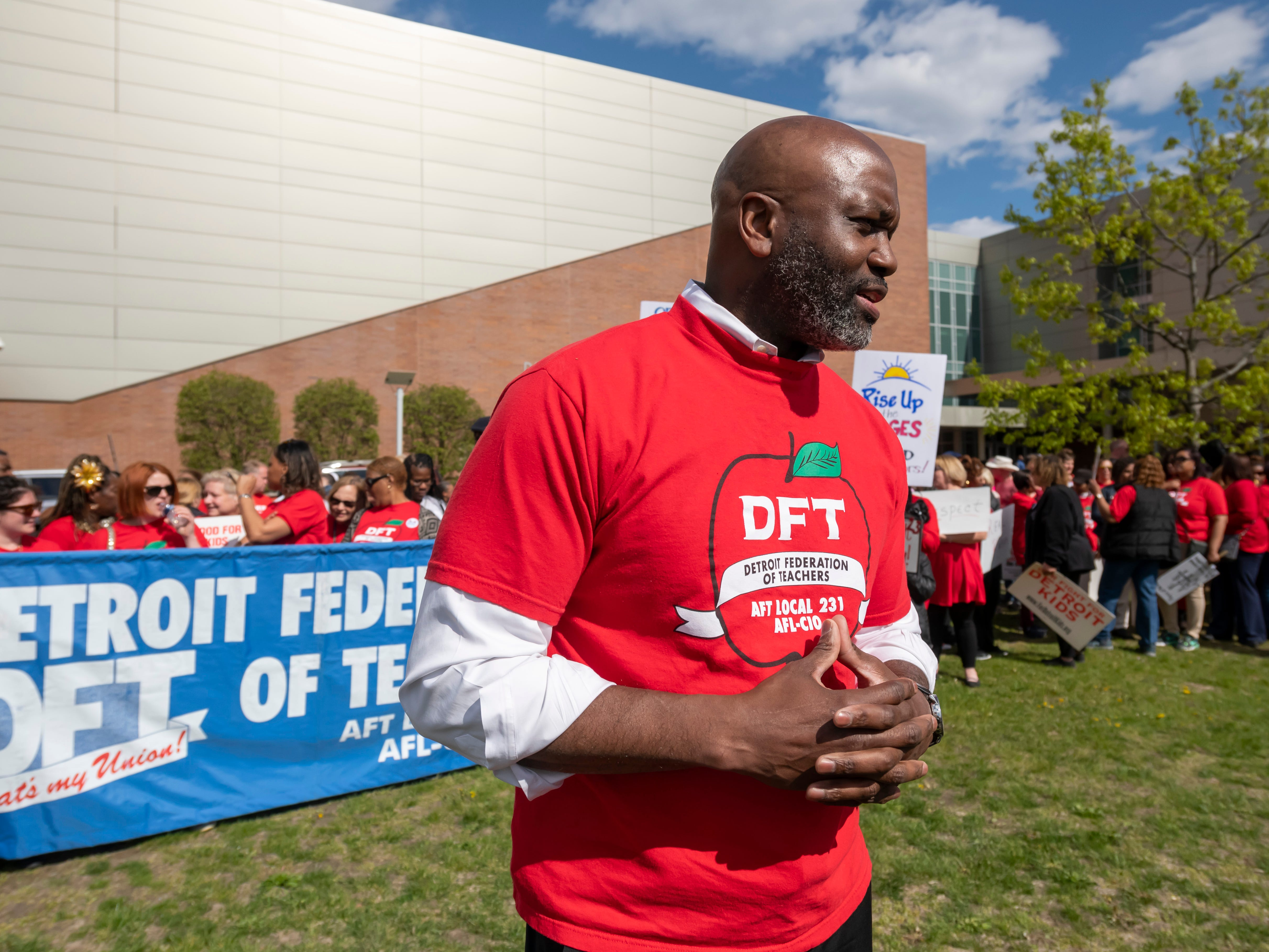 Terrence Martin, president of the Detroit Federation of Teachers, speaks to reporters during a protest before a school board meeting at Renaissance High school, in Detroit, May 14, 2019. The teachers are upset over a new calendar, teacher pay, building conditions and class sizes.   (David Guralnick / The Detroit News)