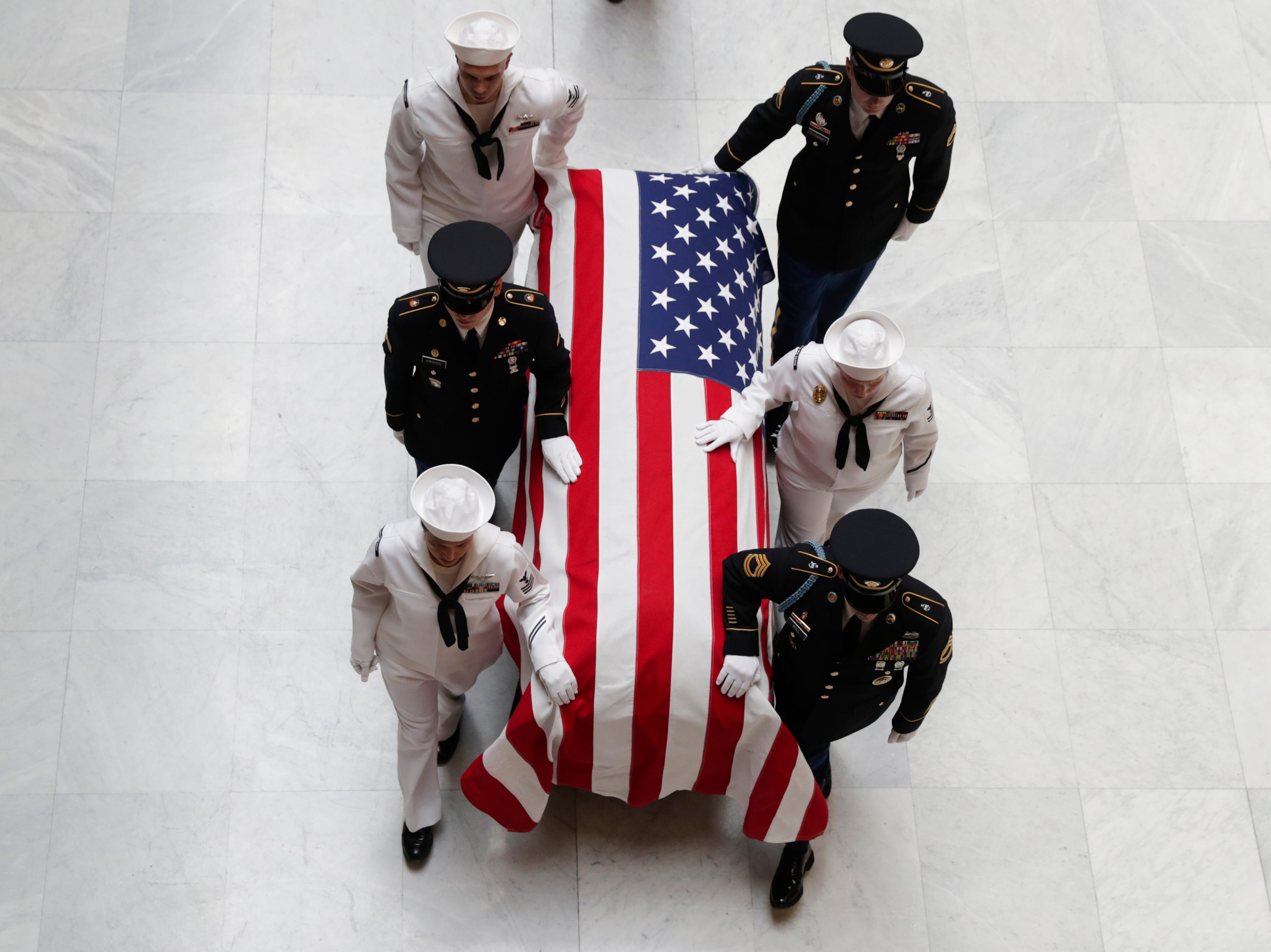 """A military honor guard escorts the casket of Sen. Richard Lugar into the Indiana Statehouse in Indianapolis, Tuesday, May 14, 2019. Lugar was a longtime Republican senator and former Indianapolis mayor who's been hailed as an """"American statesman"""" since he died April 28 at age 87."""