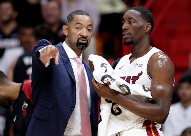 Former Michigan star Juwan Howard, left, has been an assistant coach with the Miami Heat since 2013.
