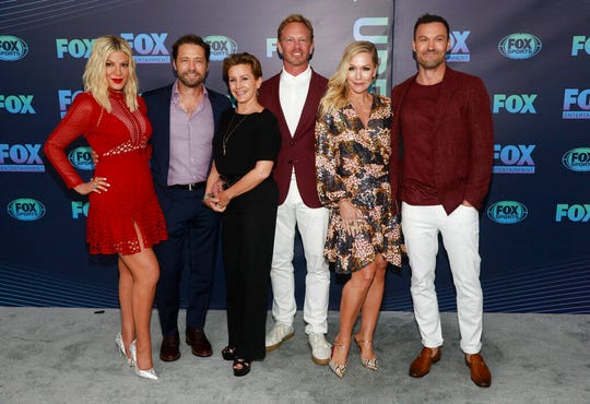 "Tori Spelling, from left, Jason Priestley, Gabrielle Carteris, Ian Ziering, Jennie Garth and Brian Austin Green, from the cast of ""BH90210,"" attend the FOX 2019 Upfront party at Wollman Rink in Central Park on Monday, May 13, 2019, in New York."
