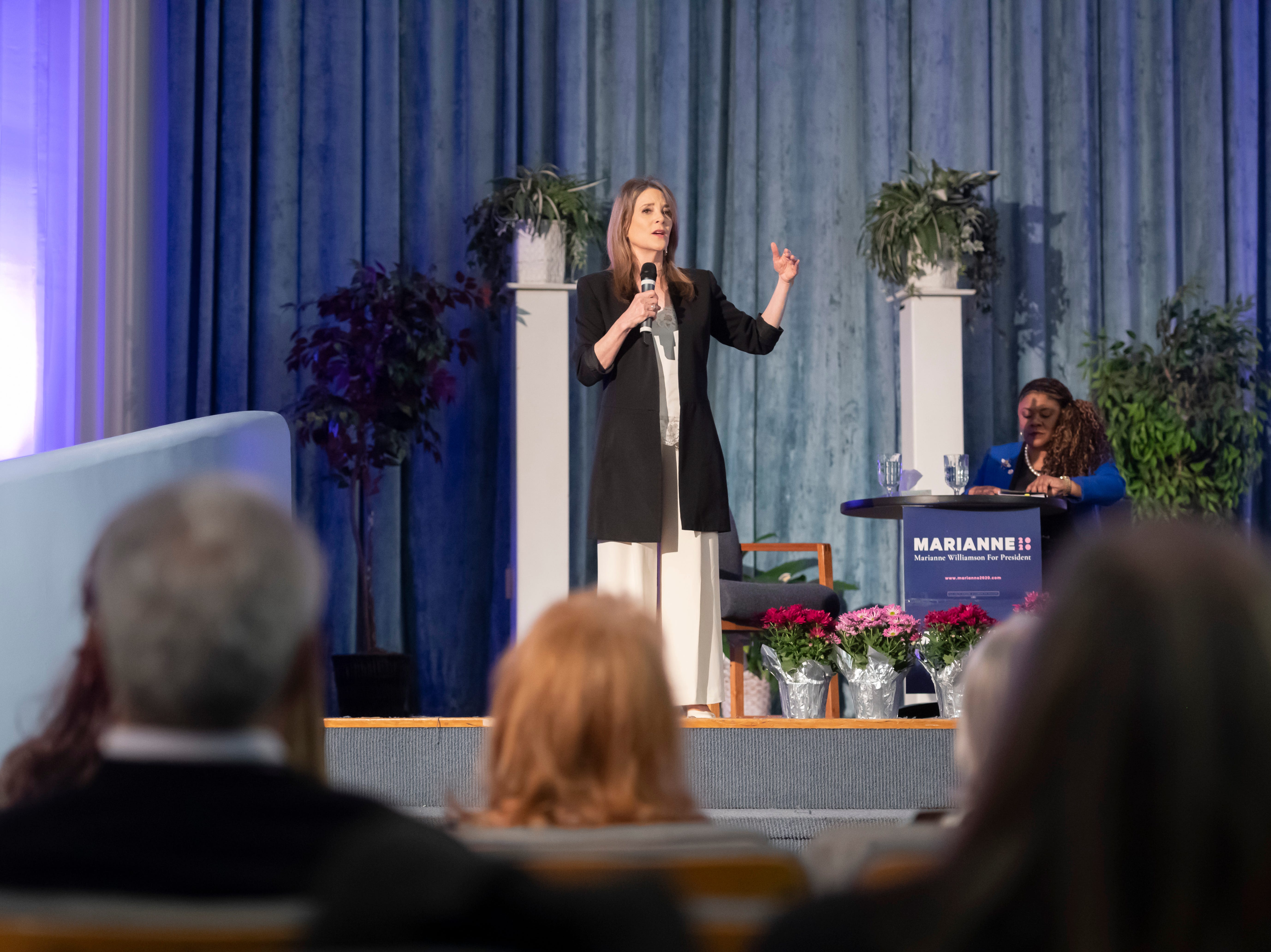 Author and Presidential candidate Marianne Williamson speaks at a town hall at the Detroit Unity Temple.