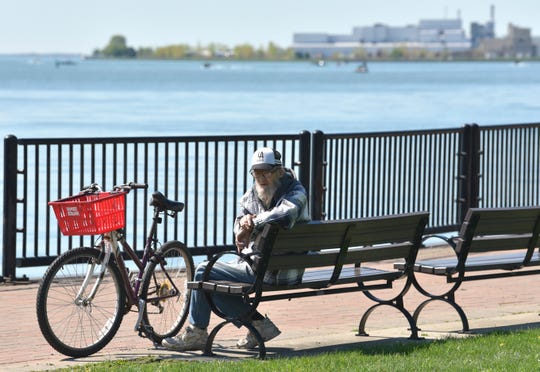 Larry Weathers, of Ecorse, relaxes on the bike trail, Tuesday morning at John Dingell Park in Ecorse.