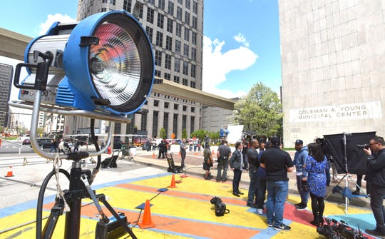 Crews use daylight-balanced halogen lights, when needed, to light up the Big Sean music video scene at Spirit Plaza in Detroit.