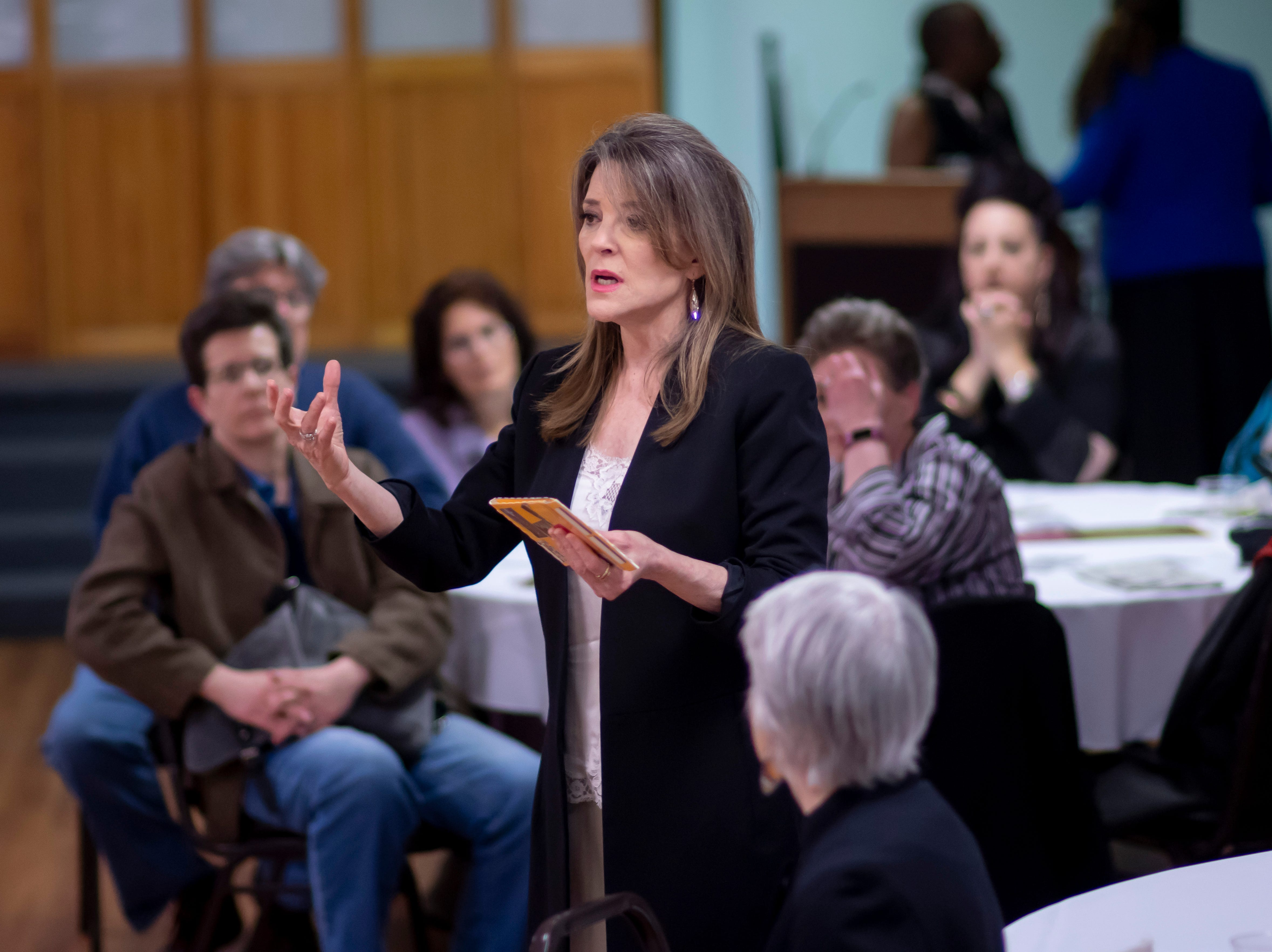 Author and Presidential candidate Marianne Williamson, chats during a VIP reception before a town hall at the Detroit Unity Temple, in Detroit, May 13, 2019.