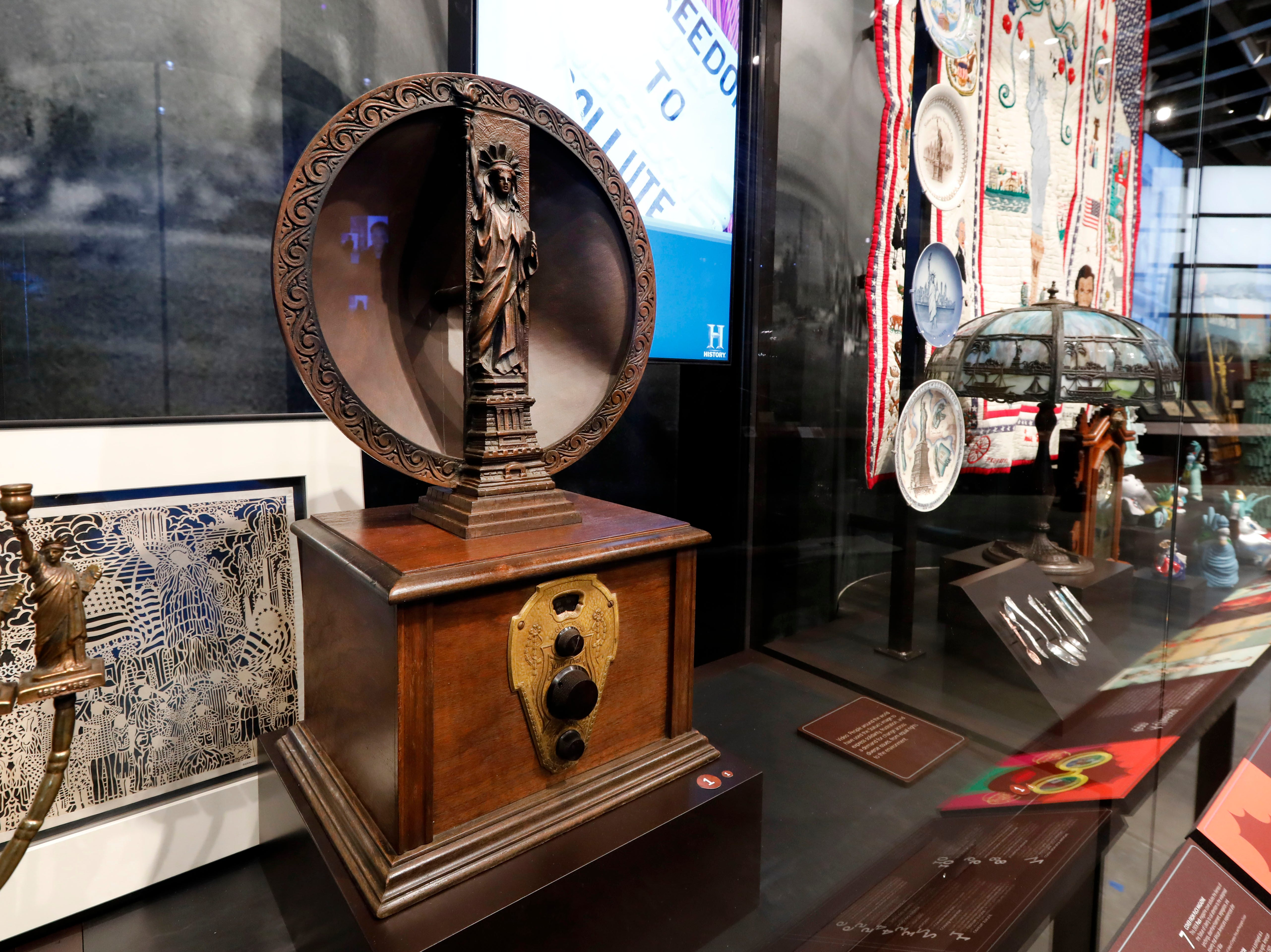 A 1920s Mohawk one-dial radio and speaker is among the artifacts displayed in the new Statue of Liberty Museum.