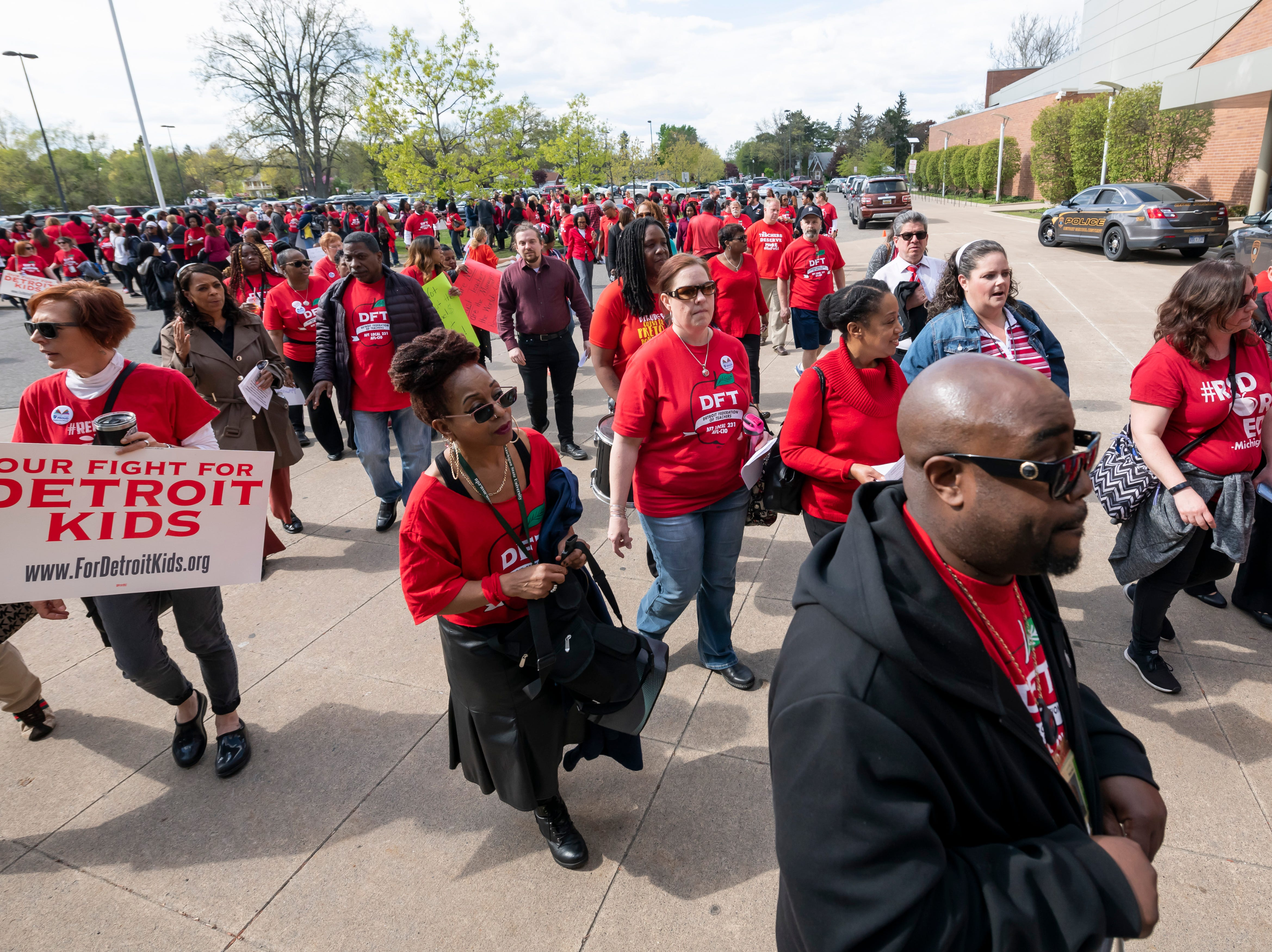 Detroit teachers and their friends and family protest before a school board meeting at Renaissance High school, in Detroit, May 14, 2019. The teachers were upset over a new calendar, teacher pay, building conditions and class sizes.   (David Guralnick / The Detroit News)