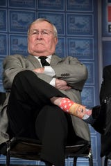 Oakland County Executive L. Brooks Patterson sports socks with the image of Donald Trump on them during the Detroit Economic Club luncheon at Cobo Hall, in Detroit, January 17, 2017.
