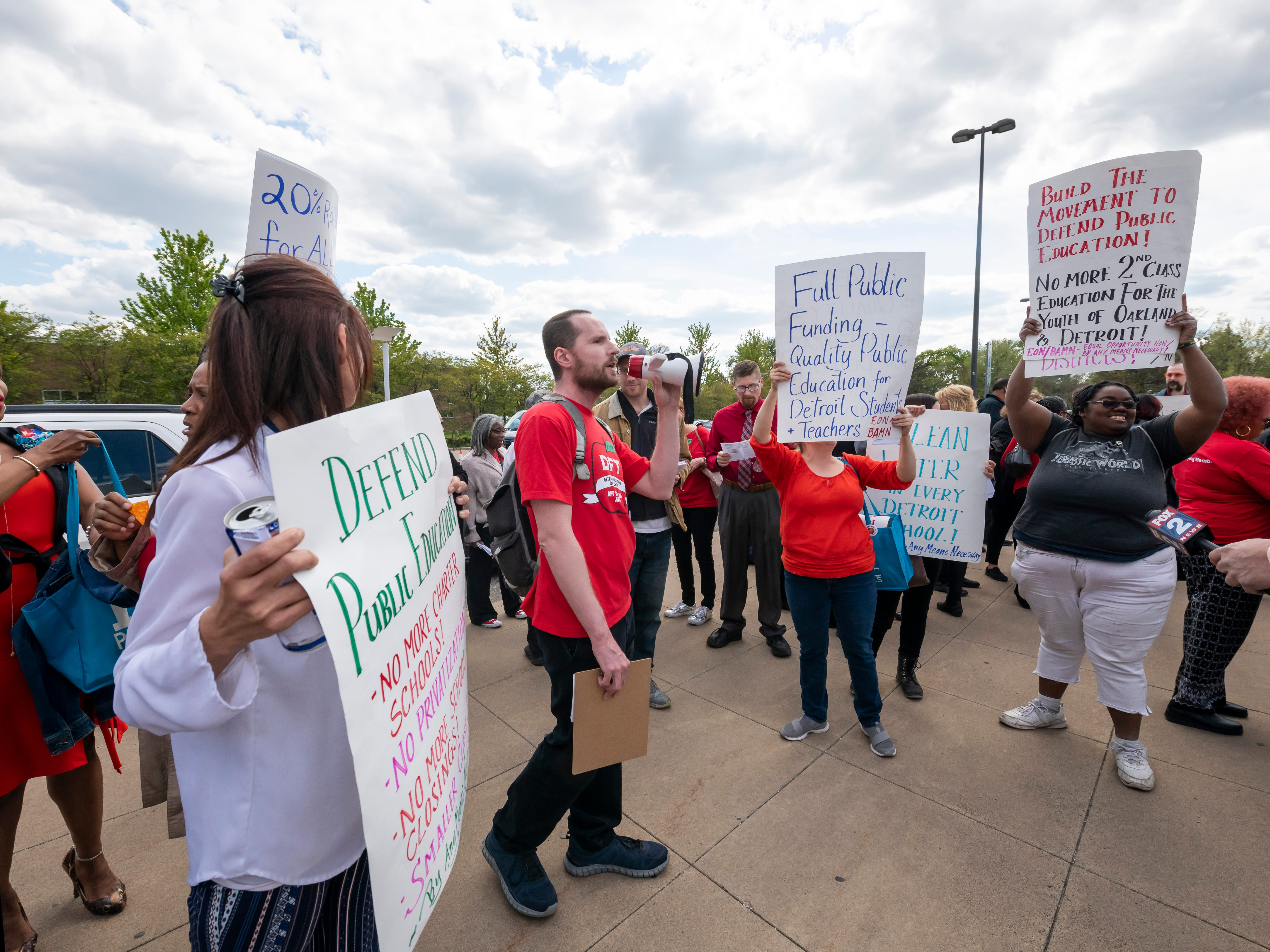 Detroit teachers protest before a school board meeting at Renaissance High school, in Detroit, May 14, 2019. The teachers were upset over a new calendar, teacher pay, building conditions and class sizes.