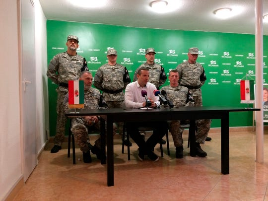 "Laszlo Toroczkai, first row center, head of Hungary's far-right Our Homeland Movement, announces the formation of the National Legion, a ""self-defense group"" created in the spirit of the Hungarian Guard, which was disbanded by the courts in 2009 in Budapest, Hungary, Tuesday, May 14, 2019."