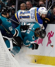 St. Louis Blues' Robert Bortuzzo (41) fights for the puck with San Jose Sharks' Kevin Labanc, left, and Marcus Sorensen (20) during the first period in Game 2 Monday. Bortuzzo scored his first postseason goal in the Blues' 4-2 victory.