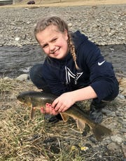 Kylee Margeit, 9, showing off a big sucker from Catharine Creek, is the fourth generation of a Southern Tier family of angling enthusiasts.