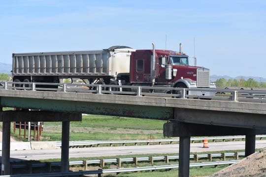 A semi-truck crosses Vine Drive Bridge over Interstate 25 on Tuesday morning. The bridge is scheduled to be rebuilt and will be closed seven months.