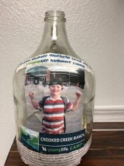 This donation jar was taken from Daily Pawn in Fort Collins May 4.