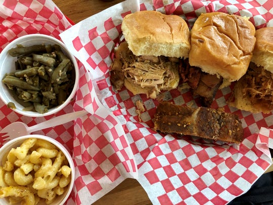 A trio of barbecue sliders from Nawty Hogg in Naples included pulled pork, brisket and pulled chicken. The combo also came with a baby back rib and two sides.