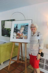 """Cape Coral artist Cheryl Fausel and her painting, """"Reflections of ZurichII."""" The watercolor work is part of the """"Art Lives Here"""" exhibit, now being displayed on Lee County billboards."""