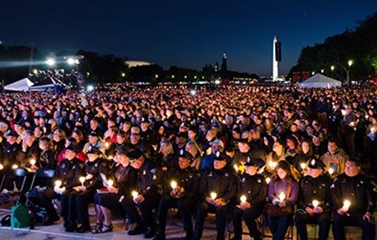 The names of 371 law enforcement officers who have died in the line of duty—including 158 who died in 2018—were formally dedicated on Monday evening, during the 31st Annual Candlelight Vigil, held on the National Mall and produced by the National Law Enforcement Officers Memorial Fund.