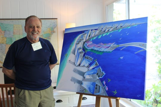 "Artist Richard Stanton poses with ""Beachwalk,"" one of nine paintings being displayed on billboards for the ""Art Lives Here"" exhibit."