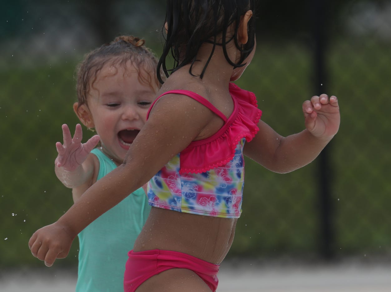 Zara Tinajero, 2, and Valentina Sosa, 4, spent the morning at the water park at Veterans Park in Lehigh Acres on Tuesday May, 14, 2019. Temperatures were hovering in the mid 80's.