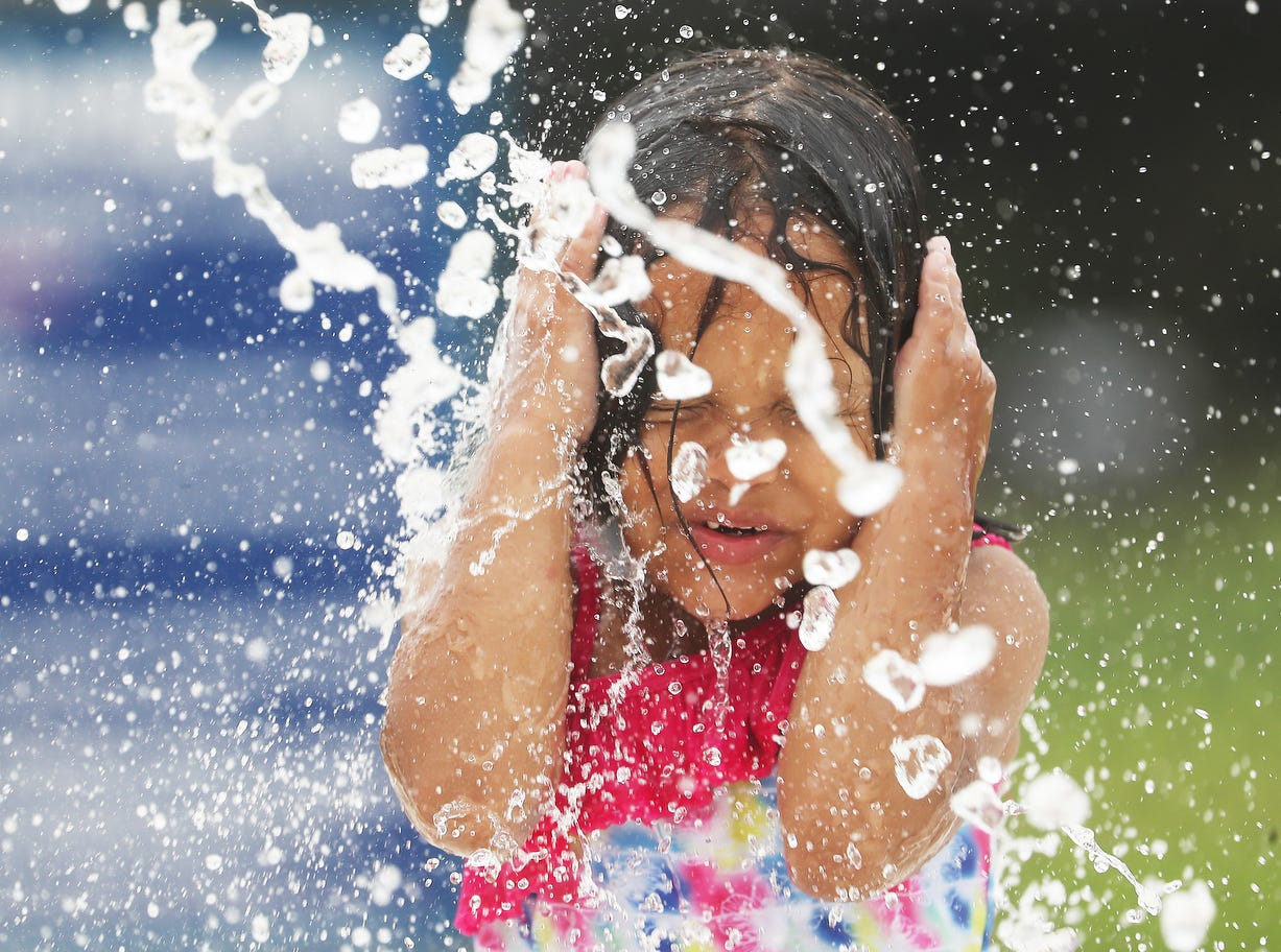 Valentina Sosa, 4, enjoys the water park at Veterans Park in Lehigh Acres on Tuesday May, 14, 2019. Temperatures were hovering in the mid 80's.