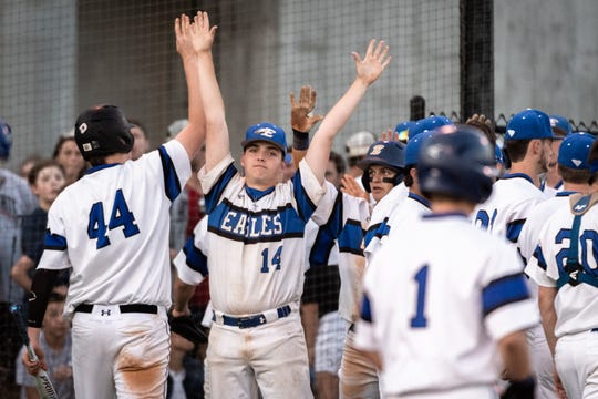 Eastside's David Clark celebrates a run scored with his teammates during game one of the AAAA state championship finals against Midland Valley Monday, May 13, 2019. Eastside won 11-1.