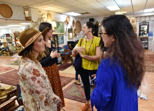 Eileen Beaver and Lindsay Jackman, left, founders of GVL Creative Connections, talk with people during a recent meeting at Cottage Grove.
