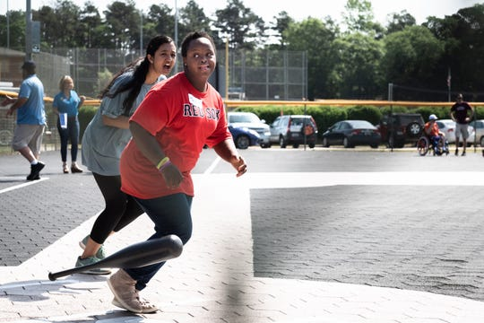 Tia Carlisle, 20, looks to her mom, Tammy Carlisle as she begins to run the bases during her Mauldin Miracle League baseball game with her siblings at Sunset Park, Saturday, May, 4, 2019.