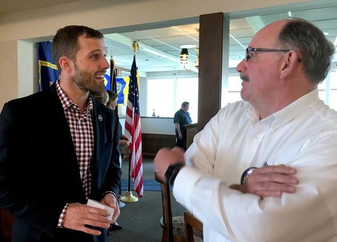 University of Montana President Seth Bodnar visits with Dean Boyle after a joint Rotary/Lions/Kiwanis clubs meeting at the Meadowlark Country Club on Tuesday. UM is trying a new approach to keep students in school, such as organizing adventures so students develop friendship before they even begin classes.