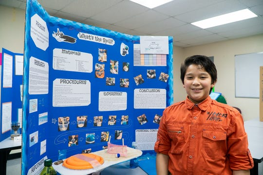 "Kay Angelo C. Rivera of Santa Barbara Catholic School, presenting his science fair project, ""What's the spill?"""