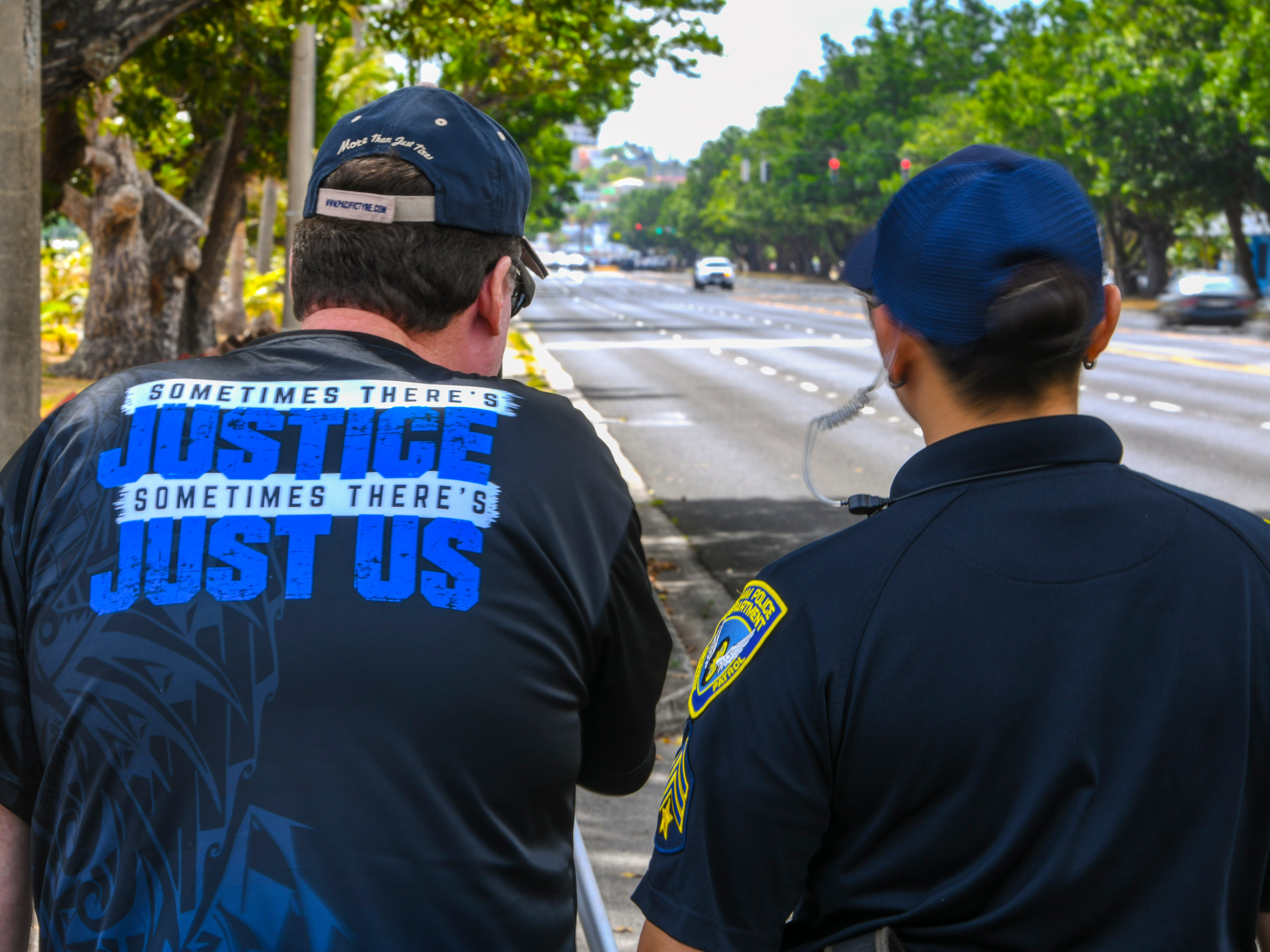 Don Perron, left, Pacific Tyre operations manager, tries his hand at operating a laser speed gun during a demonstration by the Guam Police Department's Highway Patrol Division in Anigua on Tuesday, May 14, 2019.