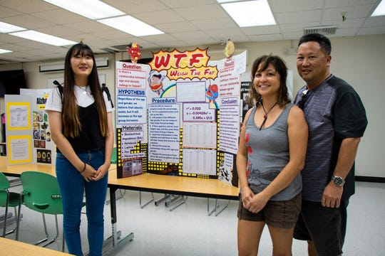 "Iris Lee of Saipan Southern High School and family, with her project, ""Weigh the Fat."""