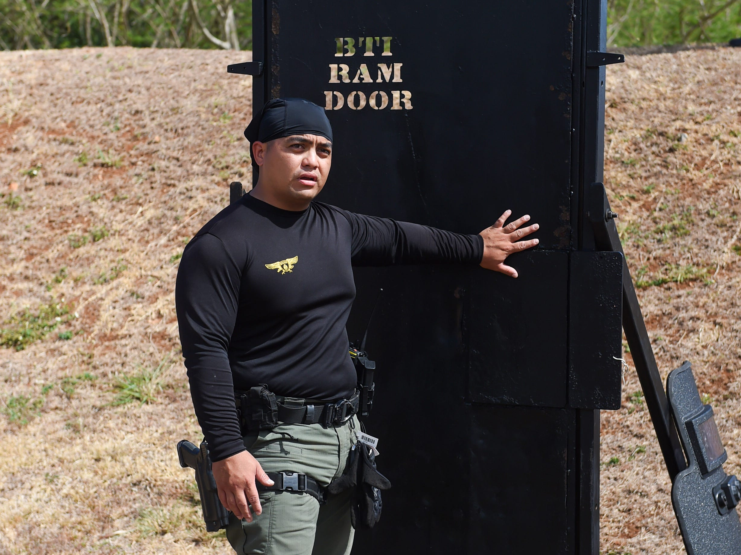 Guam Police Department officer Sotero Olpindo discusses the door breaching process during a demonstration at GPD's shooting range on the Guam Community College campus in Mangilao, May 14, 2019.