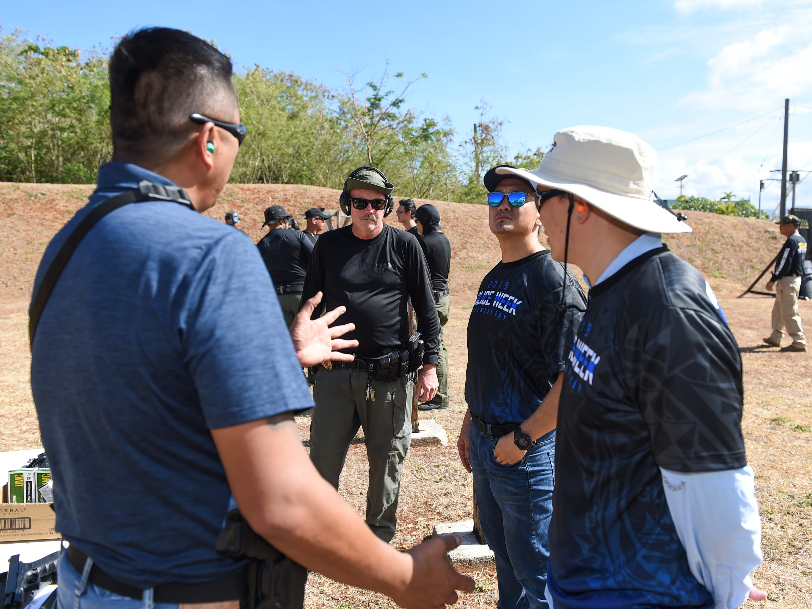 Local business executives are briefed on firearms safety by Guam Police Department officers during Police Week at GPD's shooting range on the Guam Community College campus in Mangilao, May 14, 2019.