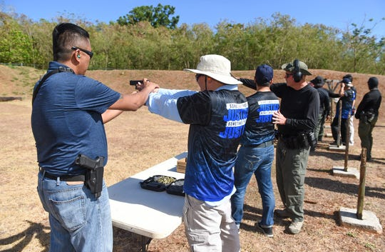 Executives from various companies receive hands-on firearms training by Guam Police Department officers at GPD's shooting range on the Guam Community College campus in Mangilao in this May 14 file photo.