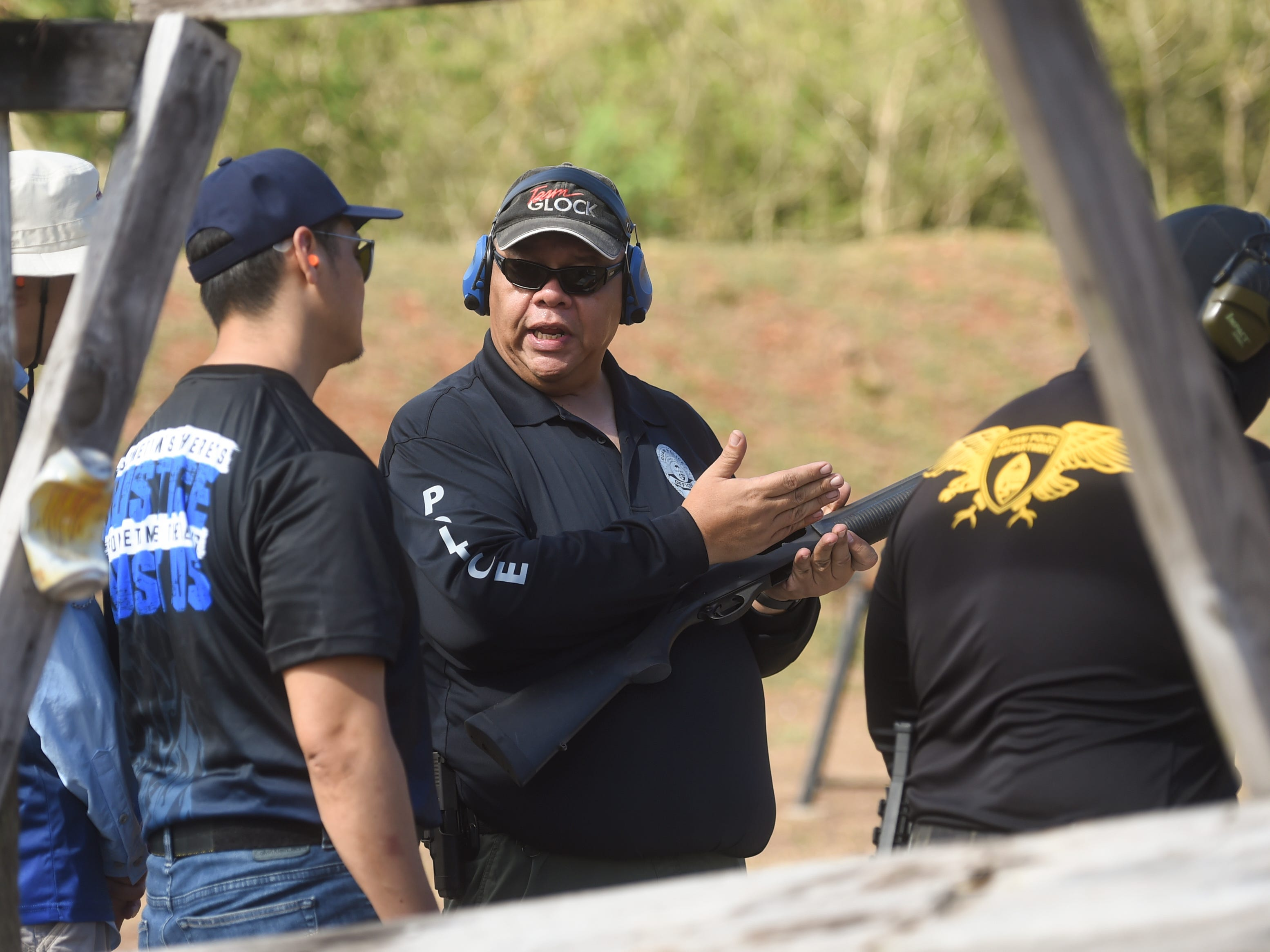 Executives from various companies receive hands-on firearms training by Guam Police Department officers in observance of Police Week at GPD's shooting range on the Guam Community College campus in Mangilao, May 14, 2019.
