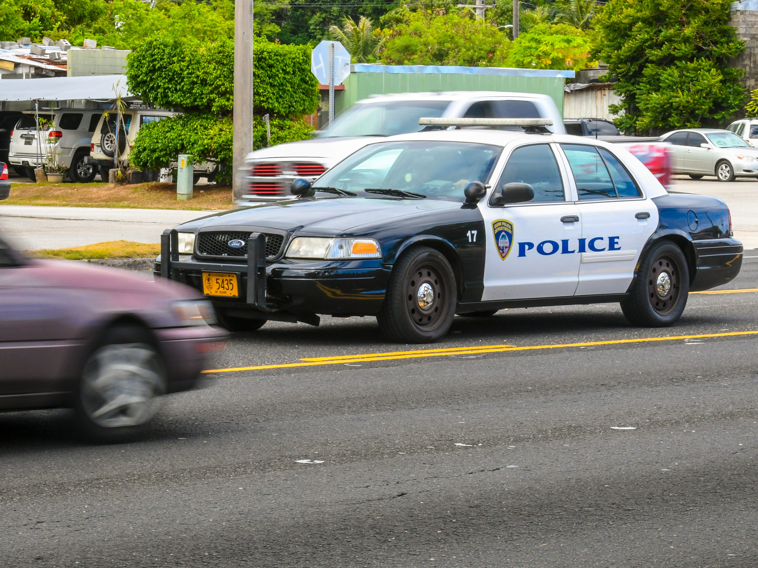 A Guam Police Department's Highway Patrol Division vehicle returns after demonstrating the capabilities of a unit equipped with a roving radar device while in Anigua on Tuesday, May 14, 2019.