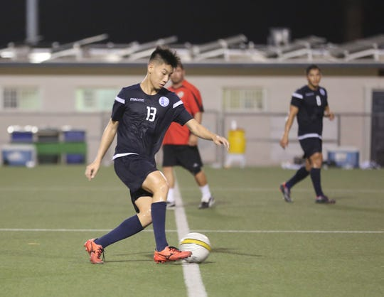 Kyle Halehale plays the ball from the midfield during a recent Matao training session at the Guam Football Association National Training Center. The 16-year-old recently accepted a call-up to the Matao.