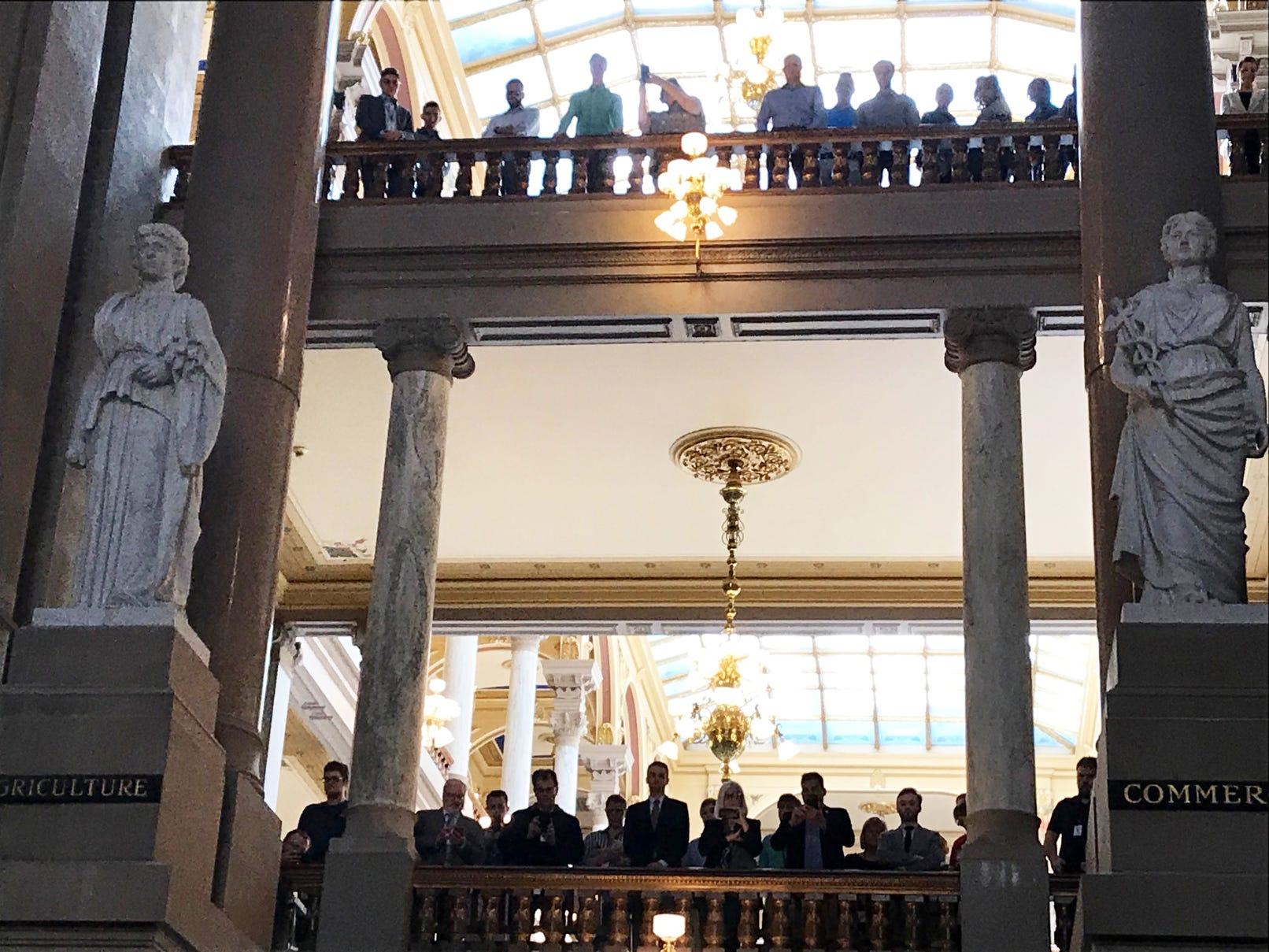 Mourners watch from the balcony as the body of former Indiana Senator Richard Lugar lies in state in the rotunda of the State Capitol in Indianapolis, Tuesday, May 14, 2019.