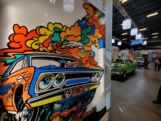 A piece of classic Road Runner art displayed as part of the The Steven Juliano Estate Collection hangs as a 1970 Plymouth Duster estimated at $150,000 to $200,000 lurks in the background.
