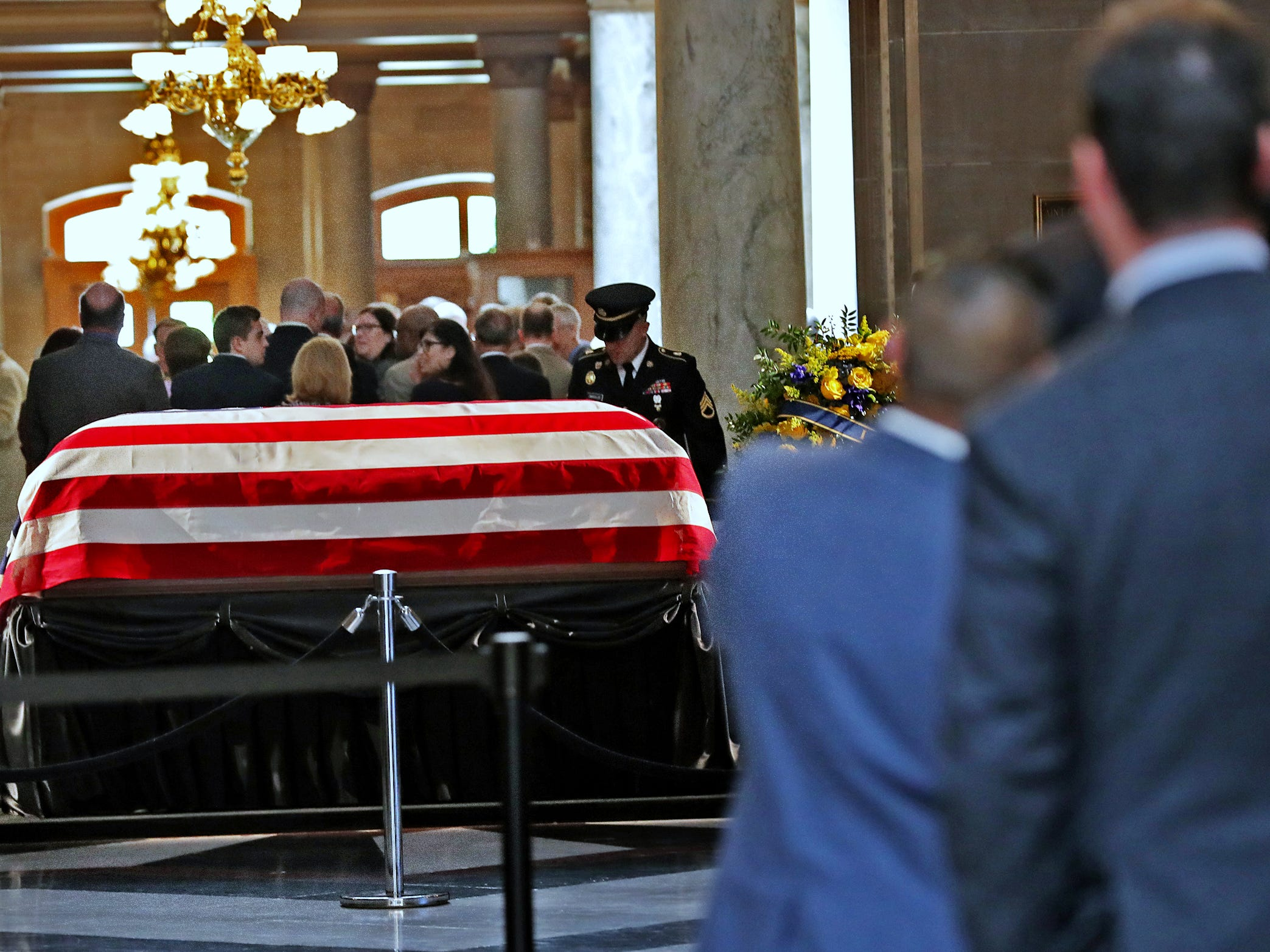 People wait to pay their respects as former Senator and Mayor Richard Lugar lies in state under the Statehouse rotunda, Tuesday, May 14, 2019.