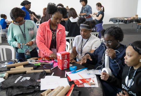 "More than a hundred area high school students took part in the 2nd annual ""Fuel the Female"" event as they began to build model race cars Tuesday at Indianapolis Motor Speedway."
