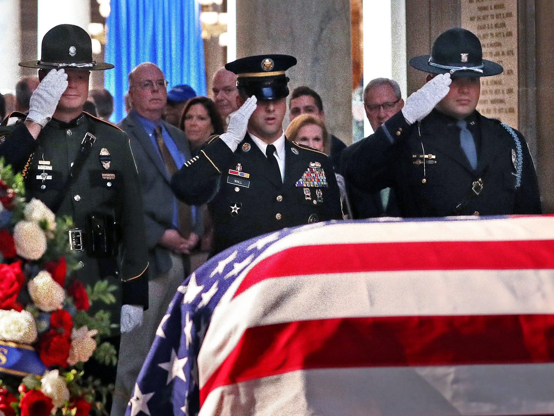 Standing honors are given as former Senator and Mayor Richard Lugar lies in state under the Statehouse rotunda, Tuesday, May 14, 2019.